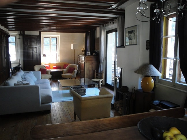Apartment Lutetia, Chamonix - picture of living room with oak floors and dark wooden beams | Beds n Board | Seasonal Accommodation Chamonix